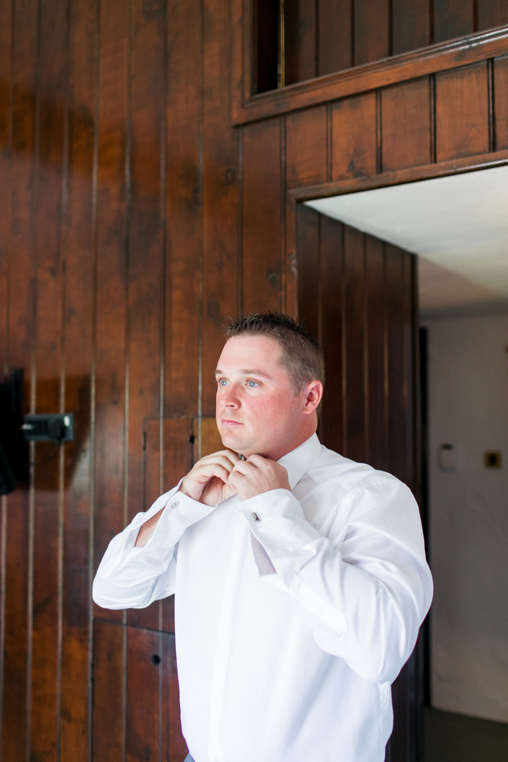 Groom getting ready before the ceremony in Bushmills hotel in Northern Ireland