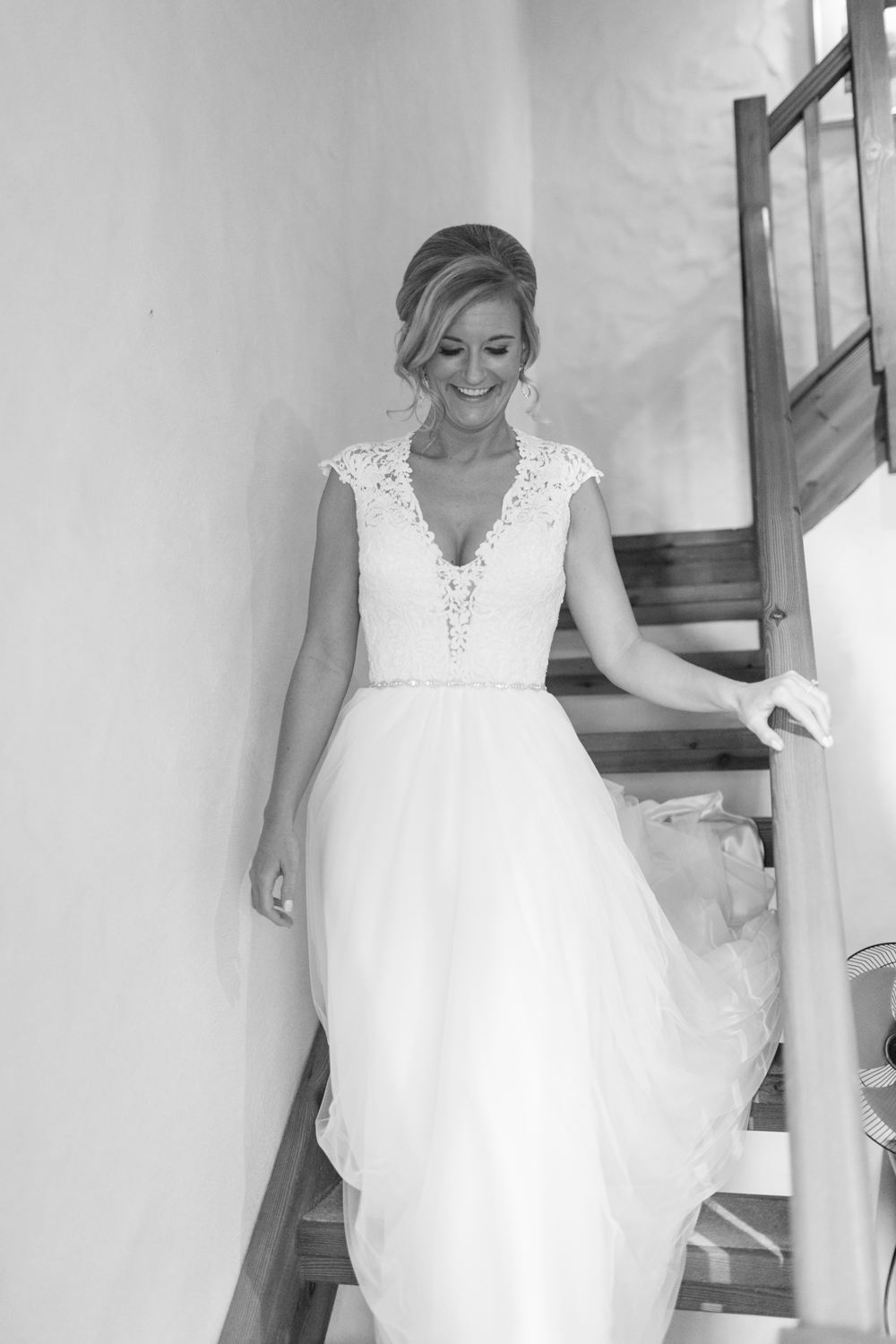 Bride coming down the stairs in her wedding dress with a tulle skirt