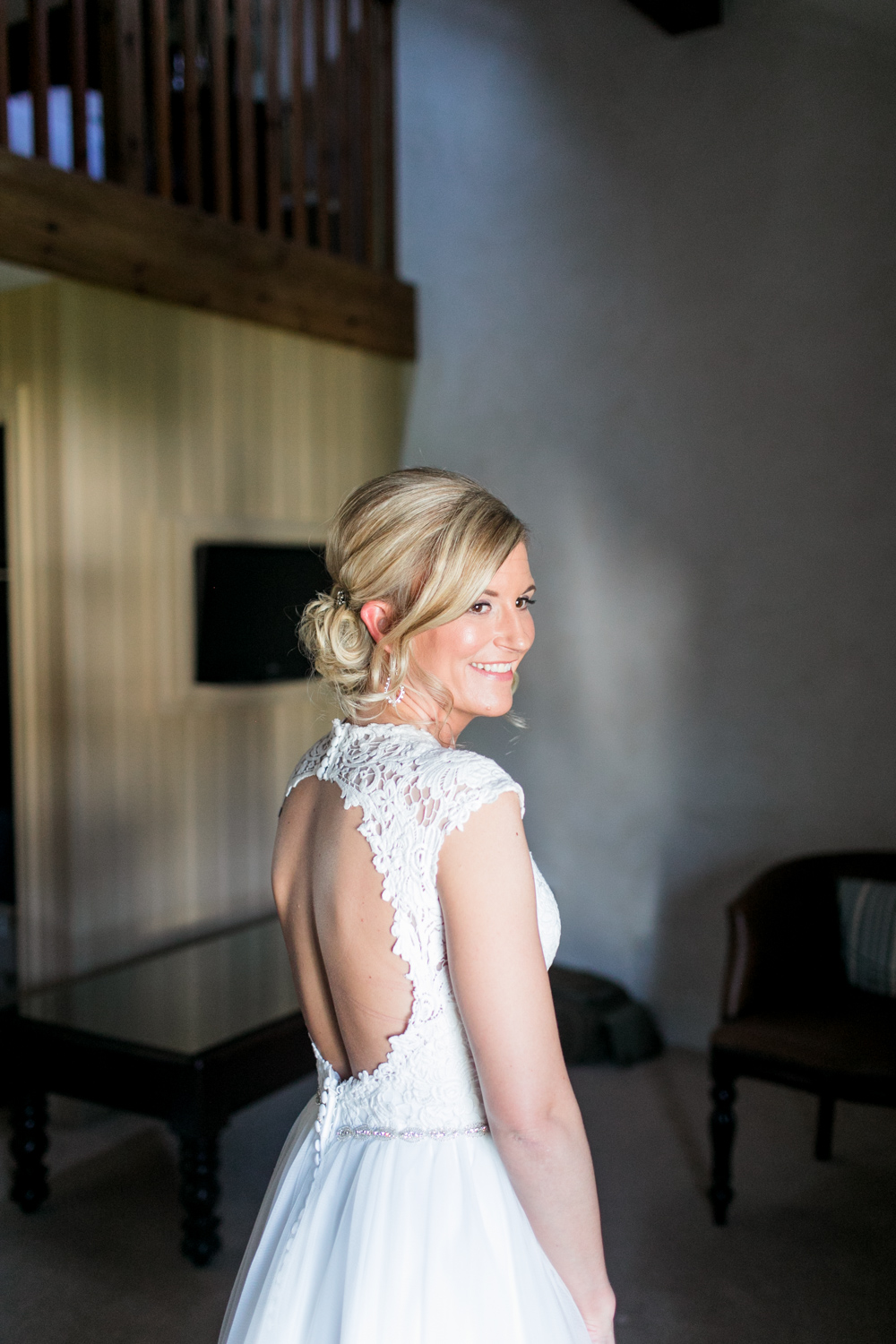 bride looking over her shoulder before the ceremony into the sunset of bushmills hotel in northern ireland