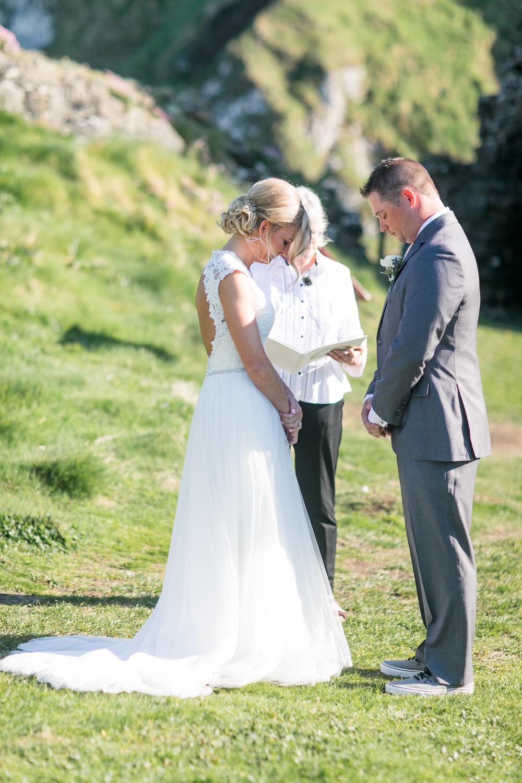 bride and groom outside ceremony in kinbane castle northern ireland