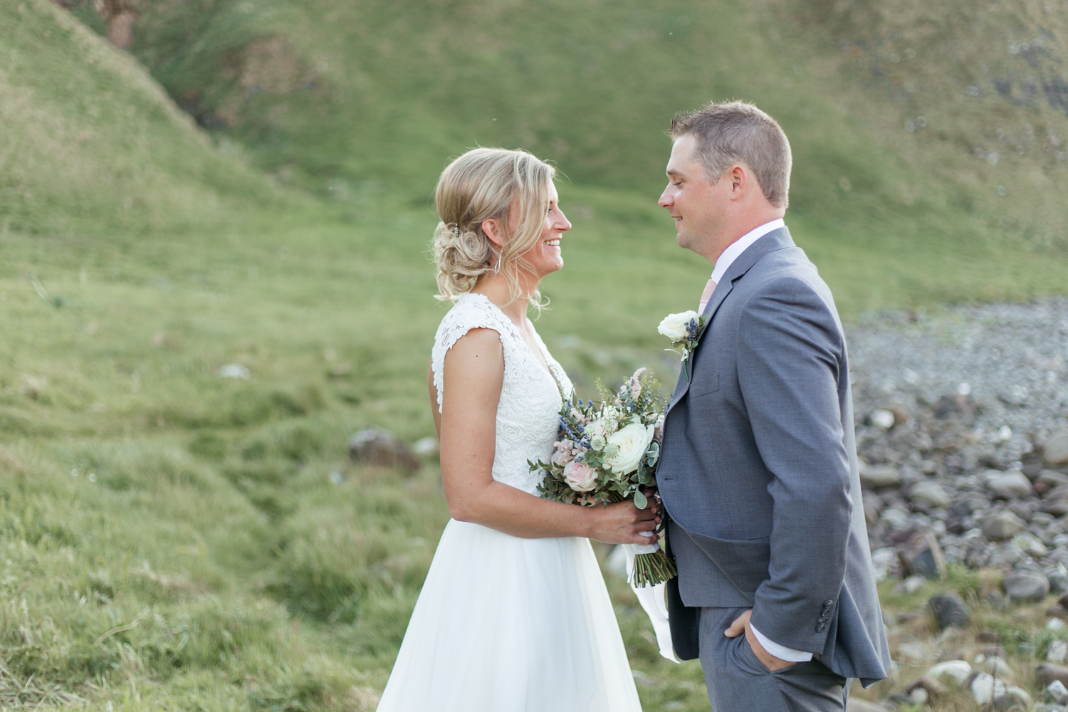 Bride and groom facing each other for bridal portraits elopement in kinbane castle