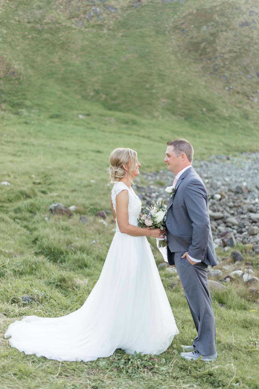 wedding tulle skirt dress bride and groom portraits in kinbane castle in northern ireland