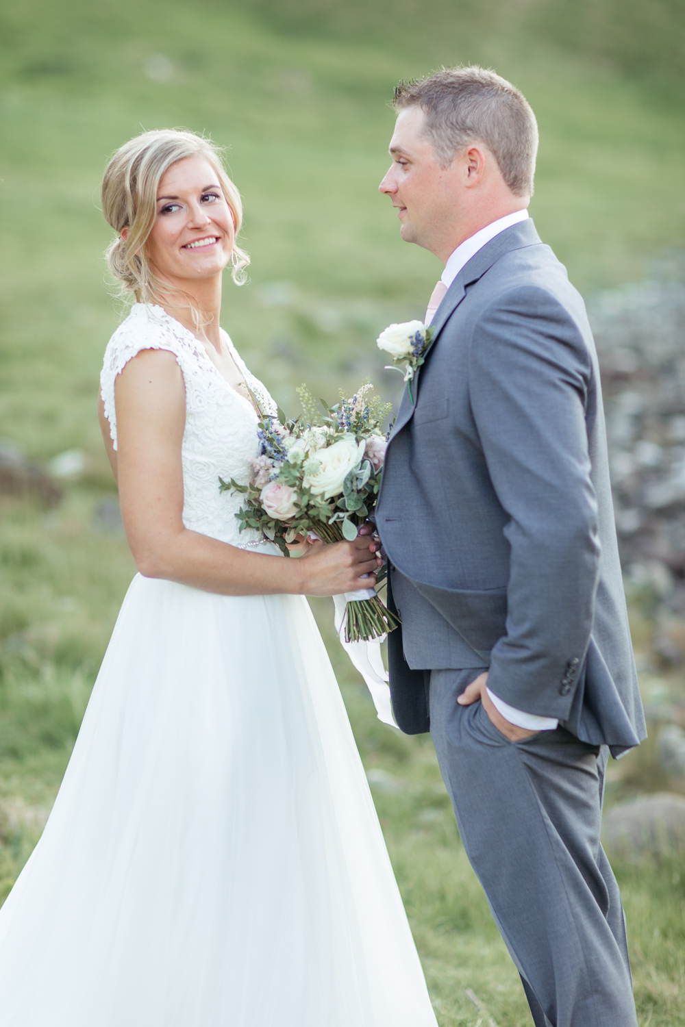 Bride and Groom posing for their bridal wedding photographs after their elopement ceremony in kinbane castle