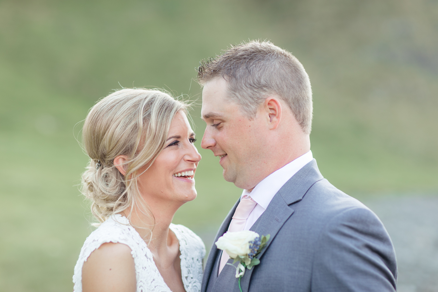 close up of bride and groom looking at each other for their wedding photographs