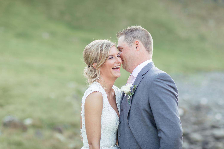 Bride laughing at the groom's joke elopement in Northern Ireland