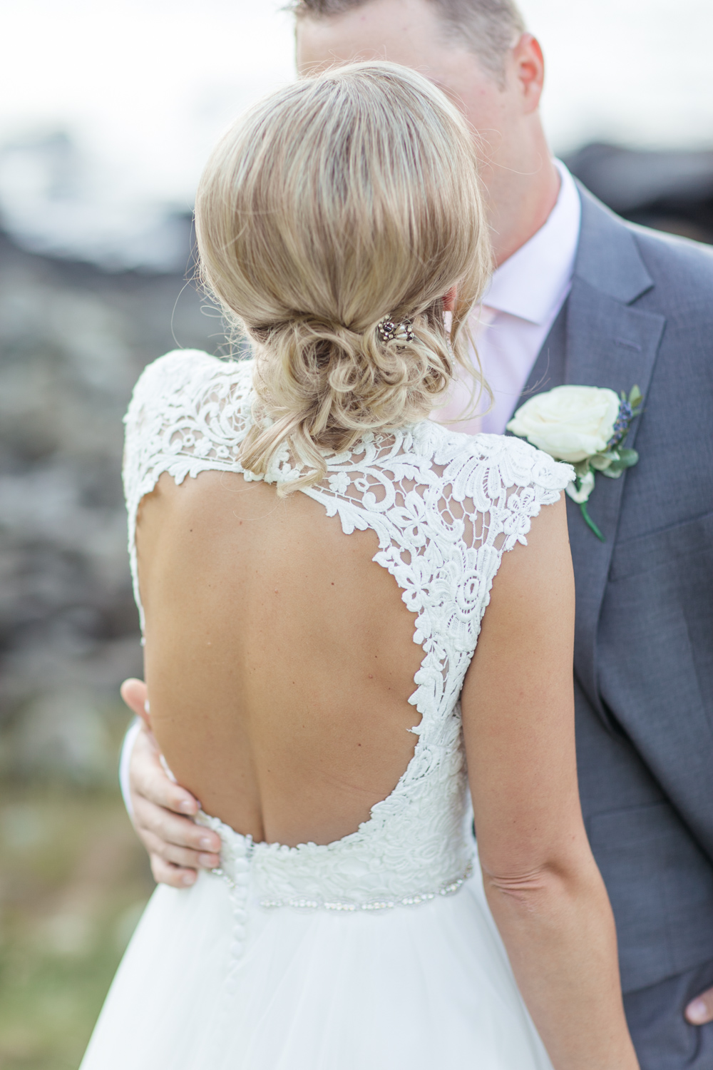 open back lace wedding dress with a loose upstyle hairdo