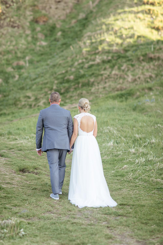 bride and groom against irish hills in northern irish landscape
