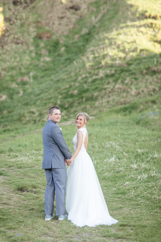 Bride and Groom posing in kinbane Castle hillside area
