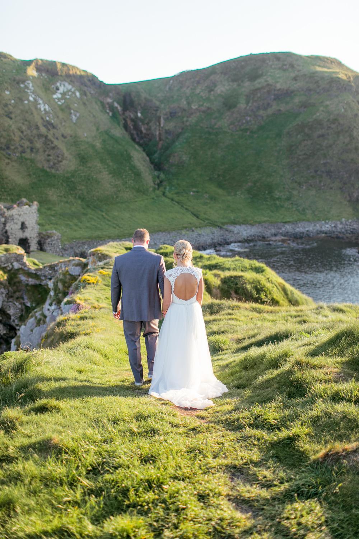 bride and groom walking towards the kinbane castle