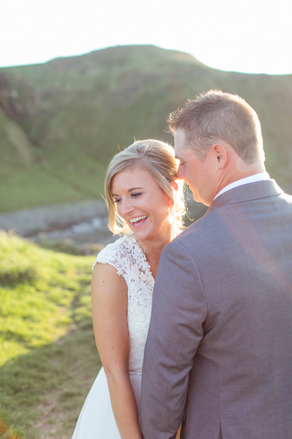 bride is naturally laughing in the photograph filled with golden sunlight