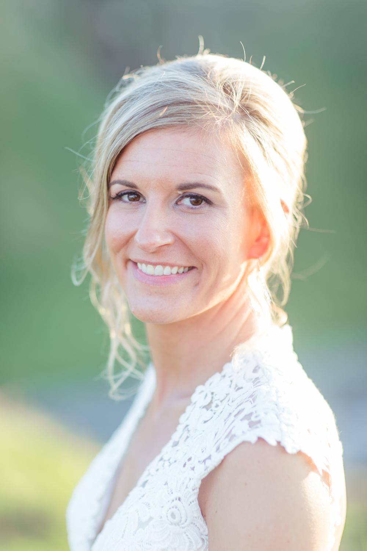 natural wedding make up with loose hair bun