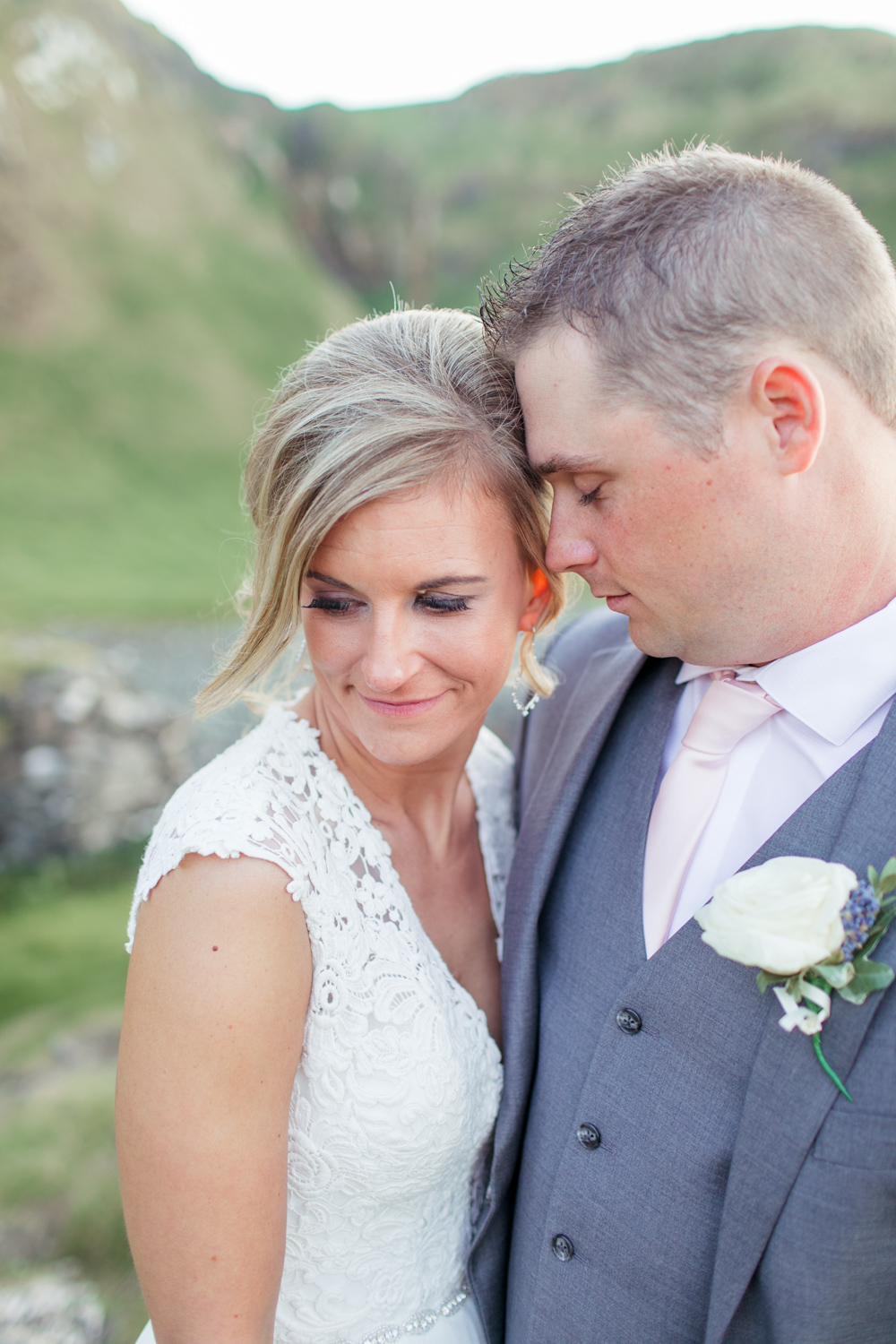 close up of a very relaxed portrait between bride and groom when their heads are together