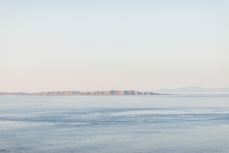 the sunset of atlantic ocean in northern ireland at kinbane castle