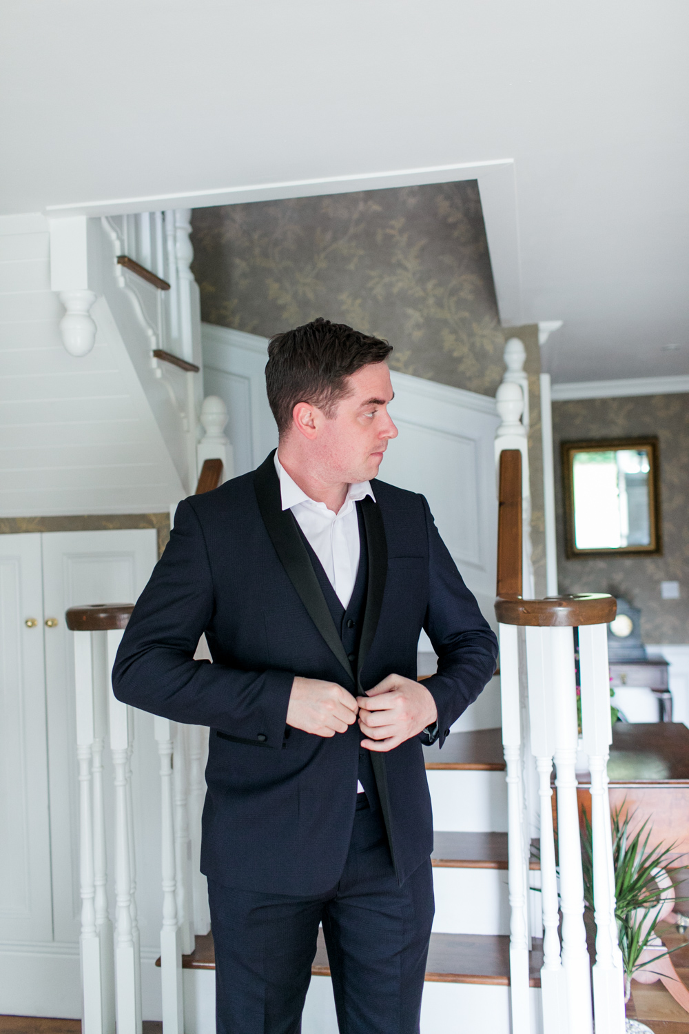 black tie tux for the groom on the morning of his wedding