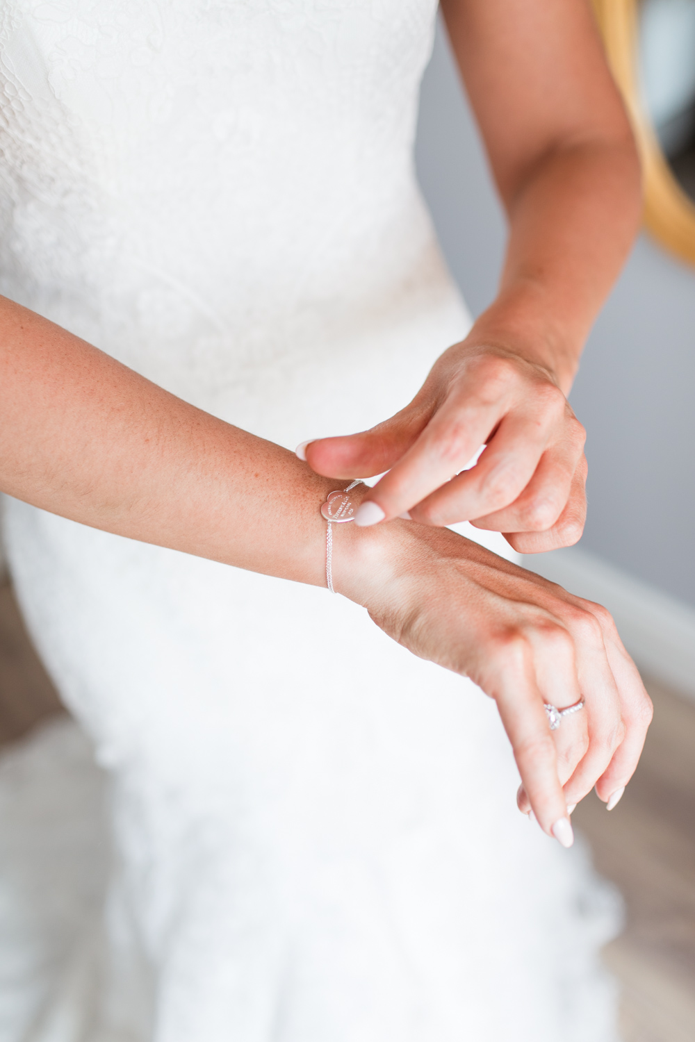 bride getting ready putting on her bracelet
