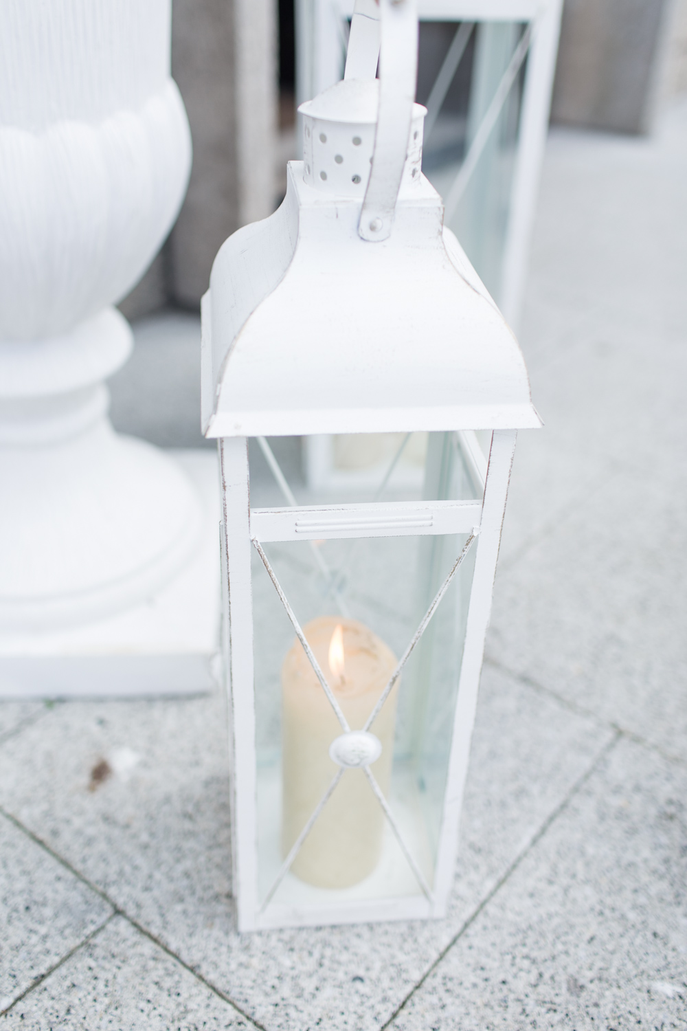 white candles for the wedding ceremony entrance outside the church