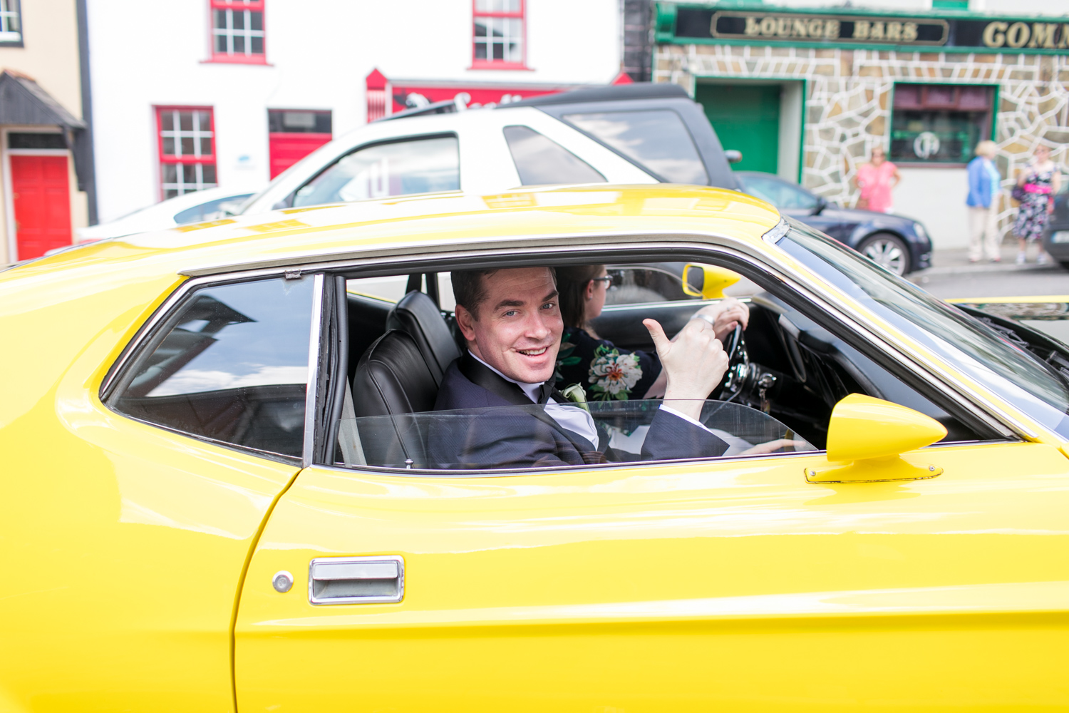 yellow mustang outside the wedding church ceremony as groom arrives