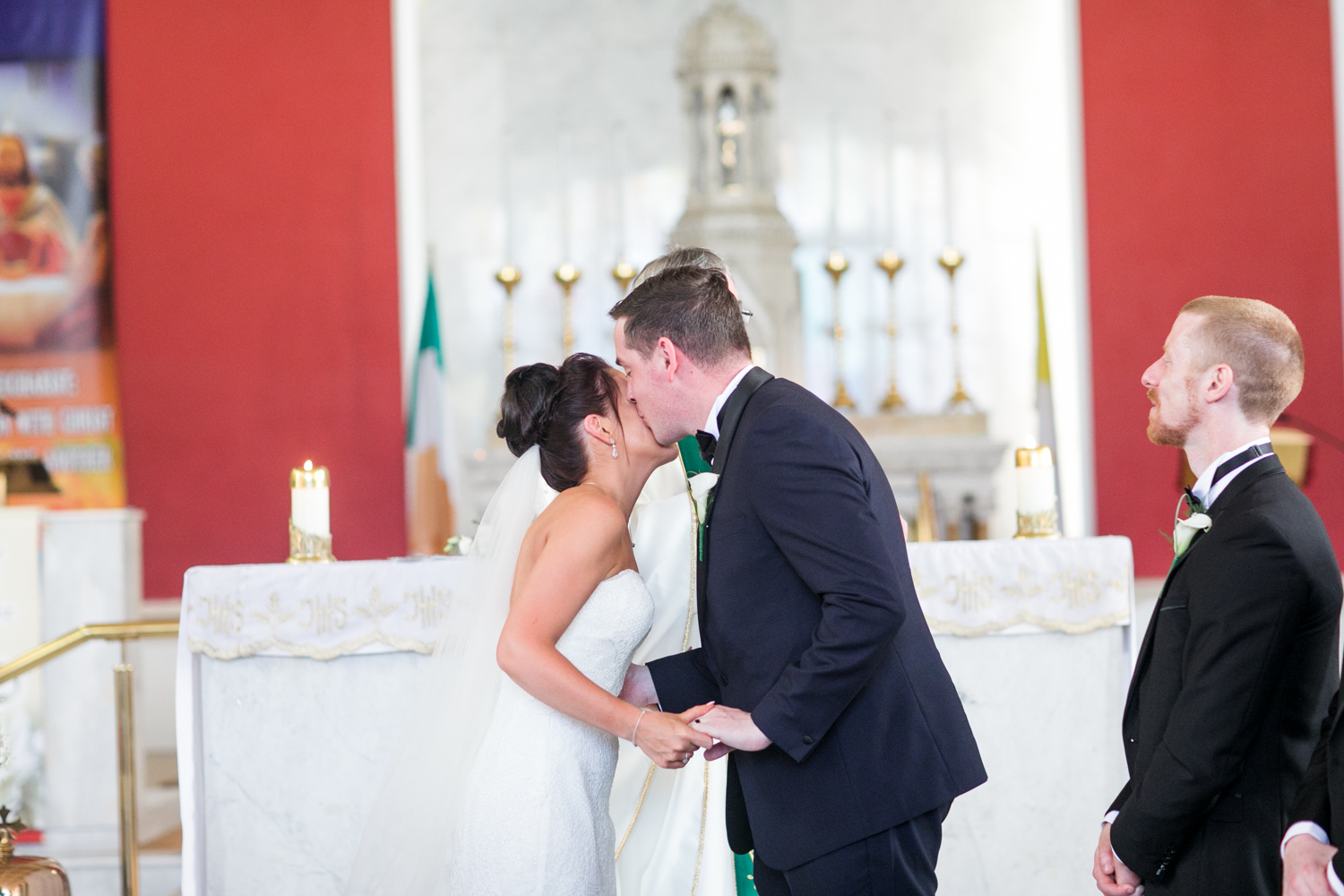 first kiss of the bride and groom at the altar