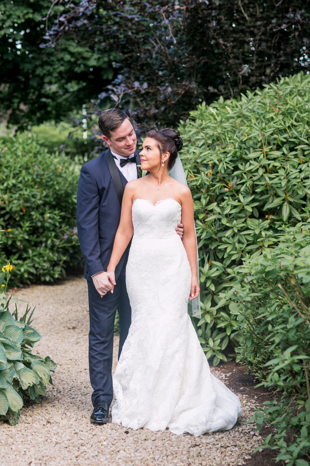 bride and groom posing for their photographs in black tux and open shoulder dress at slieve russell hotel in ireland