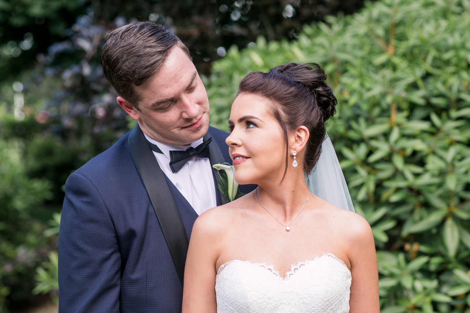 bride and groom close up photograph looking at each other summer wedding at slieve russell hotel in ireland