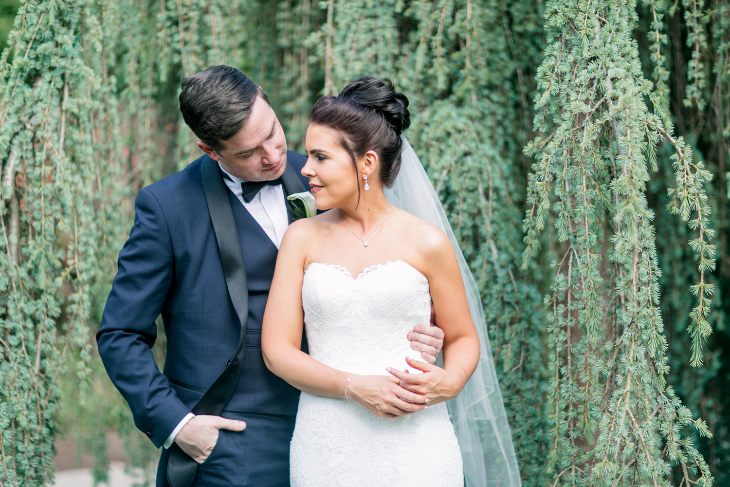 bride and groom posing with a beautiful willow tree background at slieve russell hotel in ireland