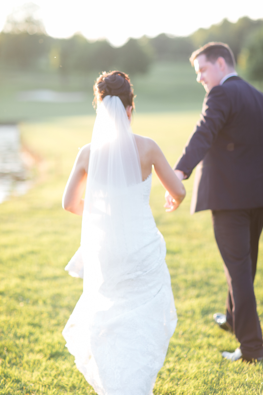 bride and groom walking away in the evening sun