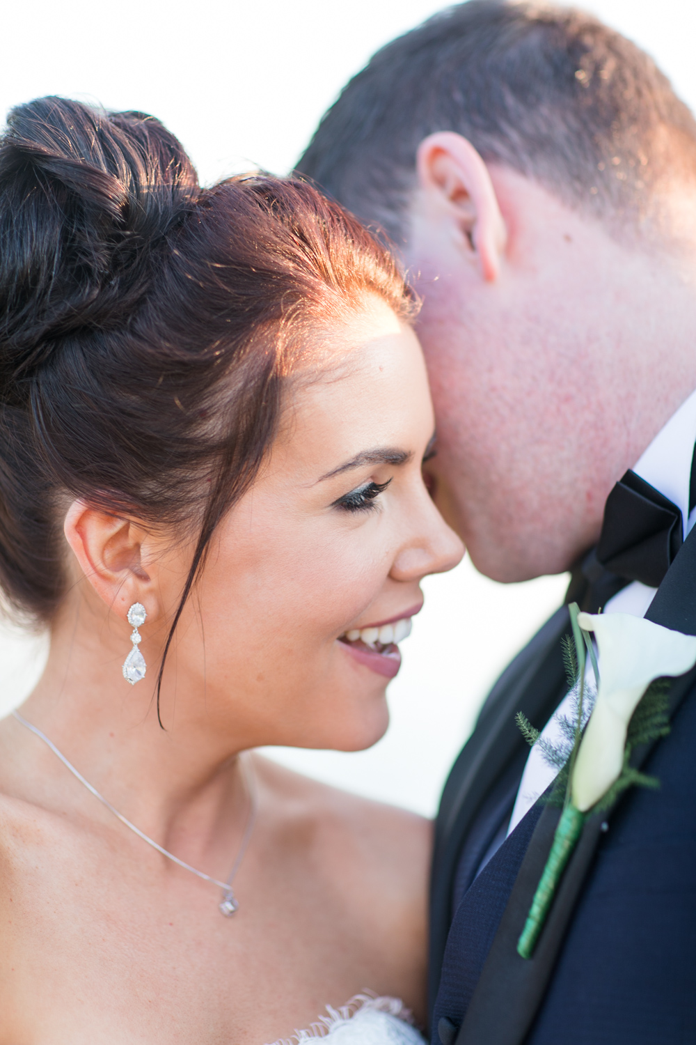 detailed photograph of a bride and her delicate wedding jewellery