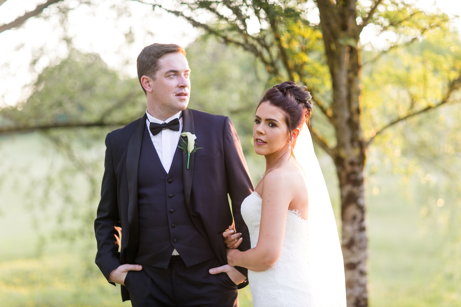 bride and groom posing in the meadow of slieve russell hotel for sun set photoshoot