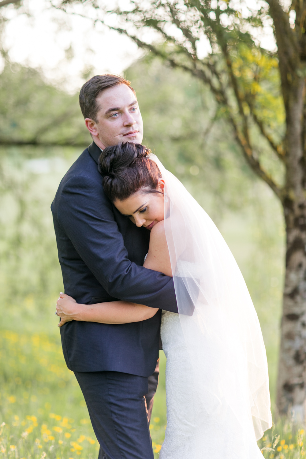 bridal photoshoot with bride and groom wrapped around each other
