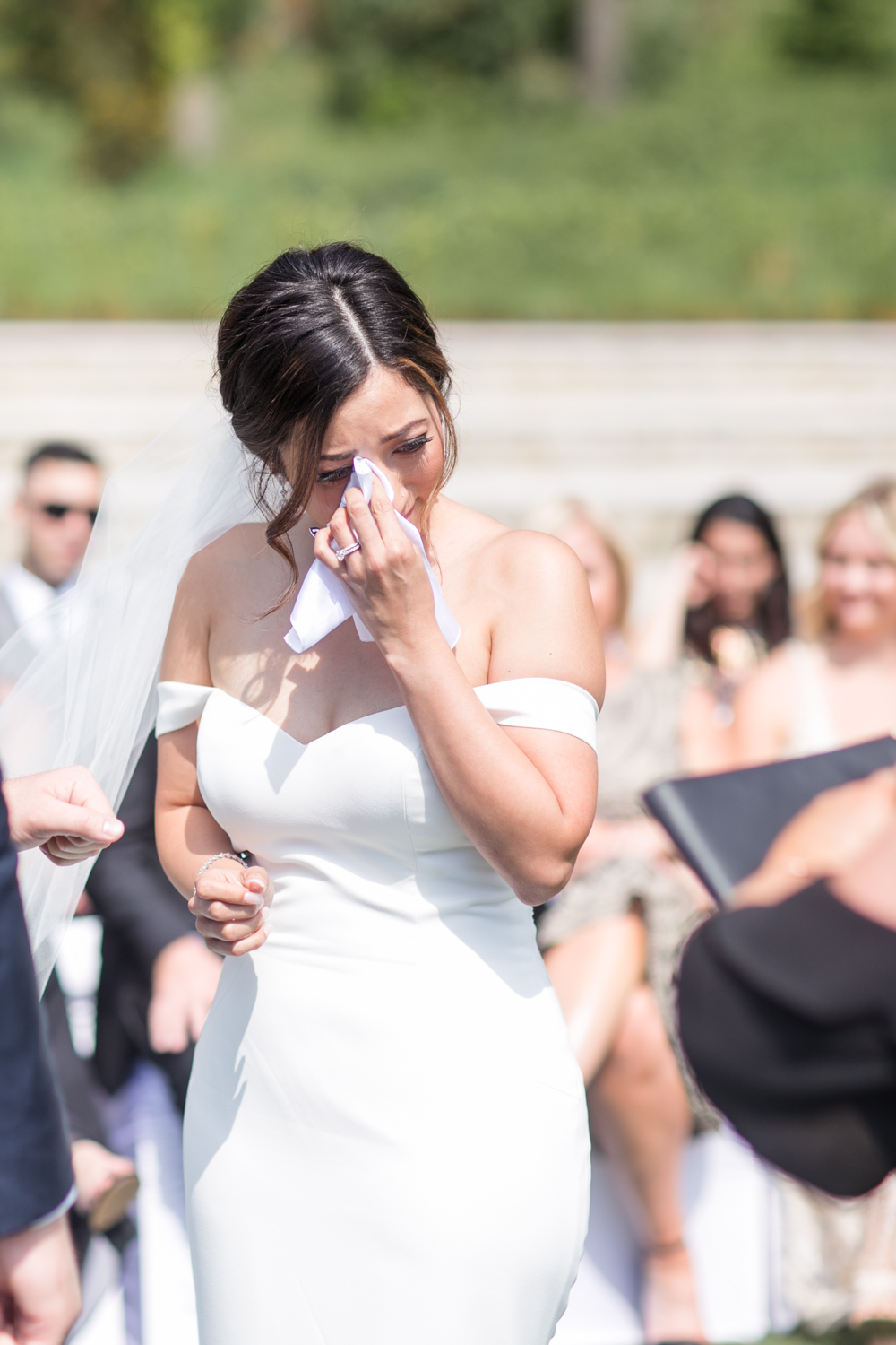 bride feeling emotional outside the powerscourt hotel during her ceremony on a sunny summer afternoon in ireland