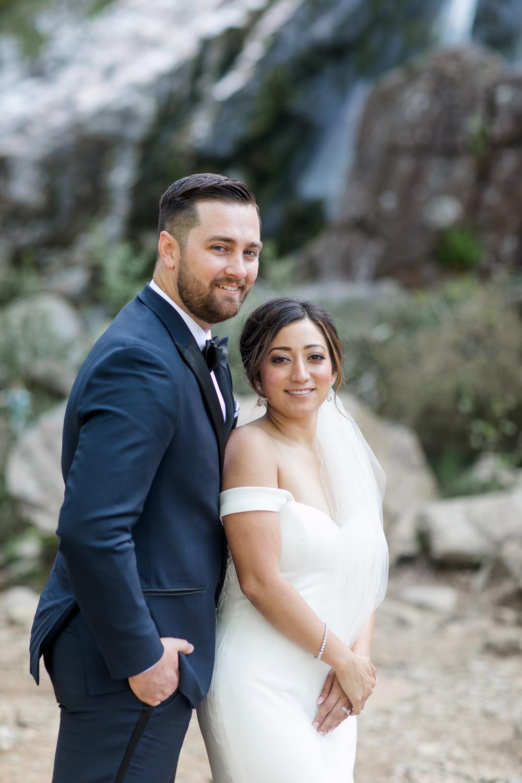 wedding photographs taken in ireland of an american elopement the couple is wearing elegant black tie wedding gowns