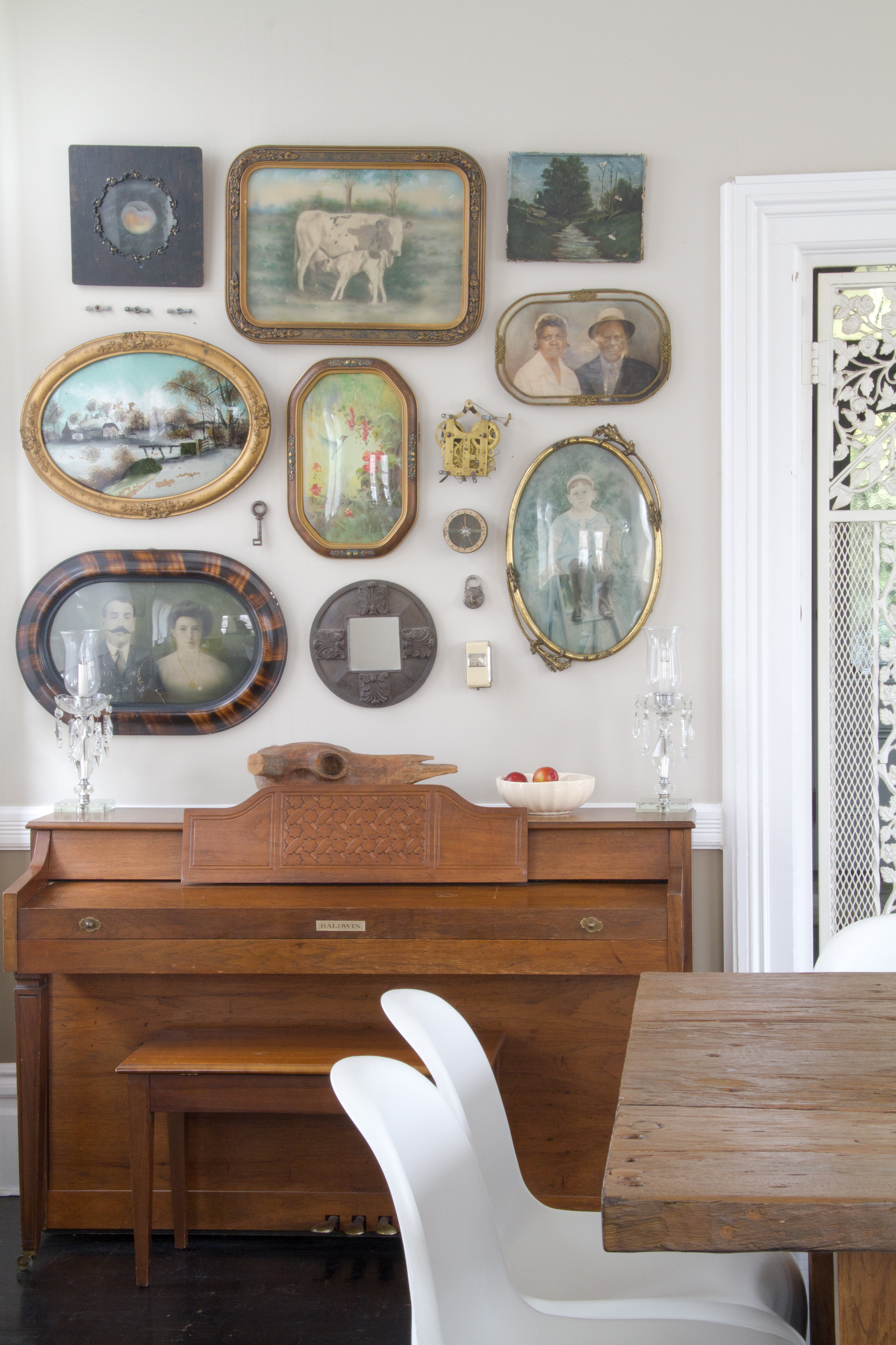 """(1/21) Suna Lock's dining room """"wall of weird."""" The wooden carved skull is a papier-mâché mold from the 1930s."""