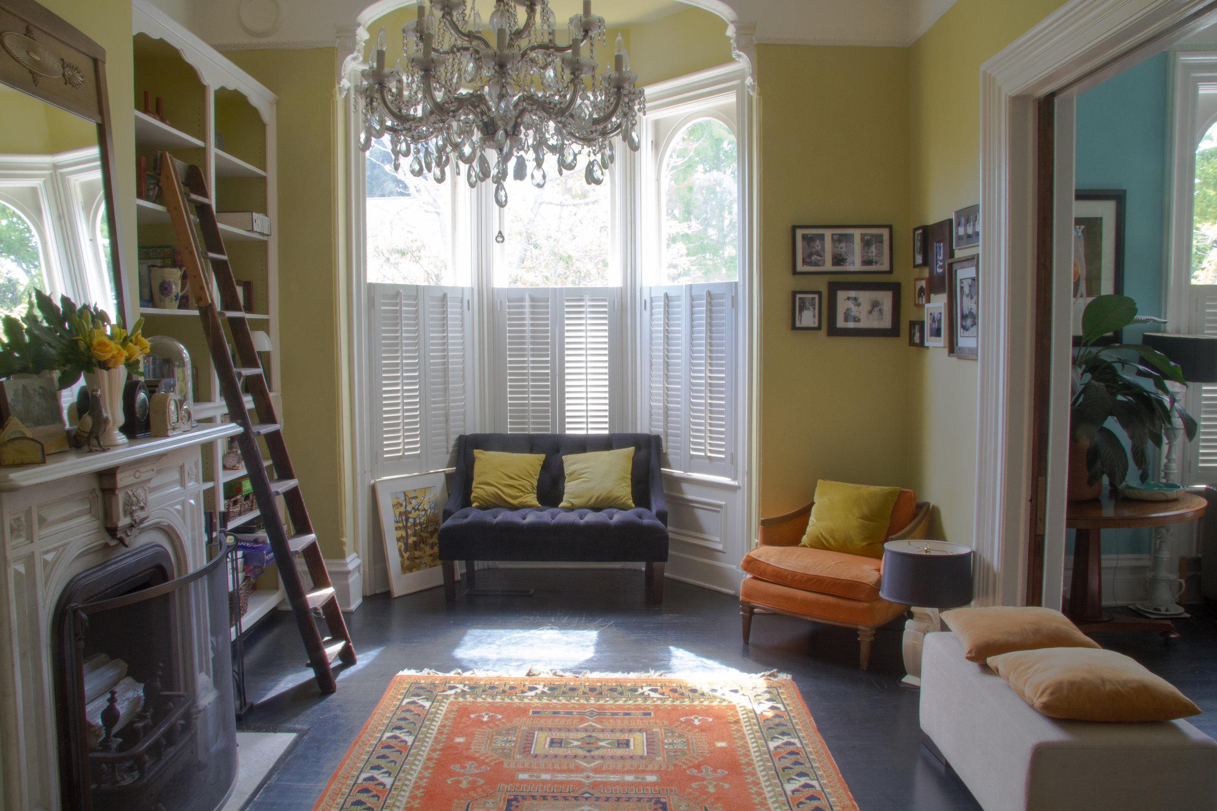 (9/21) The library has deep bay windows not seen in new constructions. Its yellow walls are covered in  Benjamin Moore Artichoke Hearts.
