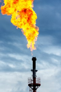 Oil torch against the cloudy sky