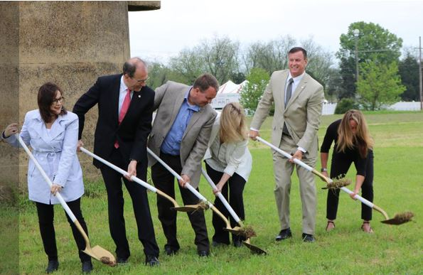(L to R) Southaven Chamber of Commerce executive director Carmen Kyle, Hosemann and Hill stand with Musselwhite and others for the ceremonial groundbreaking in front of the silo.