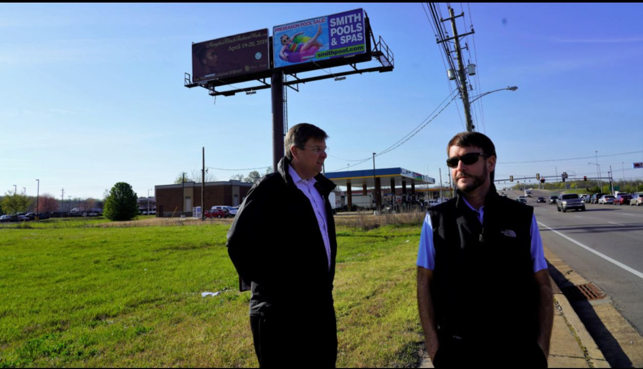 Frank Dyer III (left) and Barry Maynard of Loeb Realty Group show the lot where a Woodie's Wash Shack will be built on Whitten Road near Interstate 40.  (Tom Bailey/Daily Memphian)