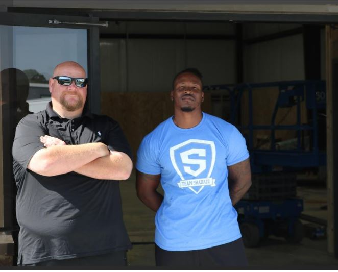 Raheem Shabazz, right, is an establish local personal trainer and the owner of Shabazz Fitness.  Shabazz will be moving and opening a new 4,800-square-foot freestanding building on July 1 at 1170 Midas Cove in Cordova.  Shabazz's clients include players of Houston High School, coached by James Thomas, shown left.