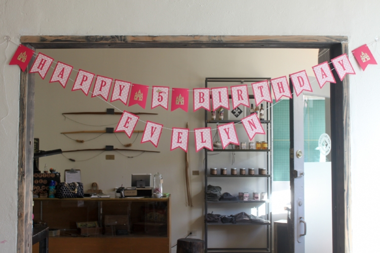 Pretty Pink Princess banner - customized with the birthday girl's name and adorned with gold glitter castles!