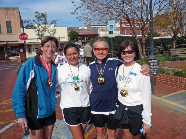 Mary (left), Lupe, Richard and Sandi (right) with their 1st Place bells at the 2007 Jingle Bell Run in Nacogdoches