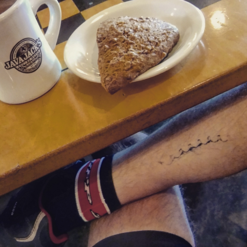 Three great things on a spring morning: Java Jack's coffee, a cinnamon scone and a chainring tattoo.