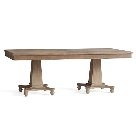 we're smitten with this pedestal dining table – now marked down at Pottery Barn!