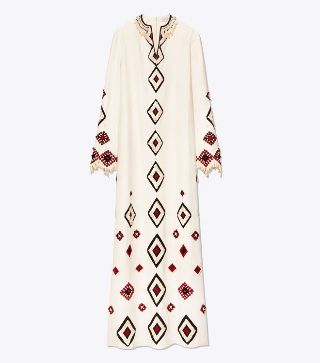 we are swooning over this  linen caftan  with the most elaborate beaded detail