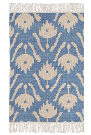 This  floral rug  is the perfect combination of both modern and traditional to add to any room. We adore the fringe detailing and you can get  it for under $90 !! It also pairs perfectly with our favorite banana leaf  counter stools  or these  bistro style stools .