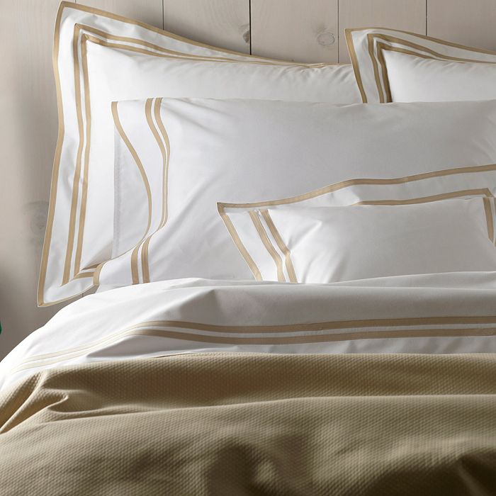 we can't get enough of this  crisp white cotton duvet set  with its contrasting ribbon border!