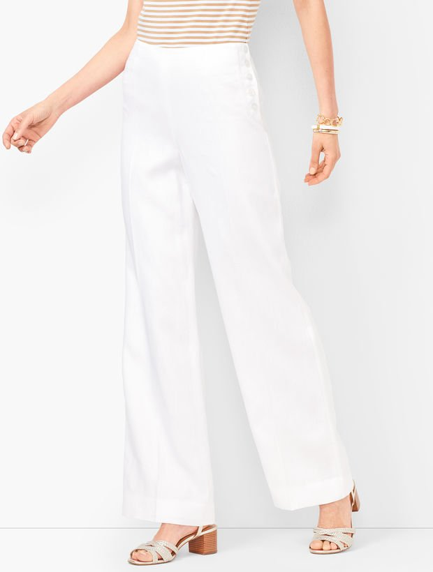 in search of a classic pair of white pants? we adore the side buttons on these retro-inspired  wide leg linen pants !