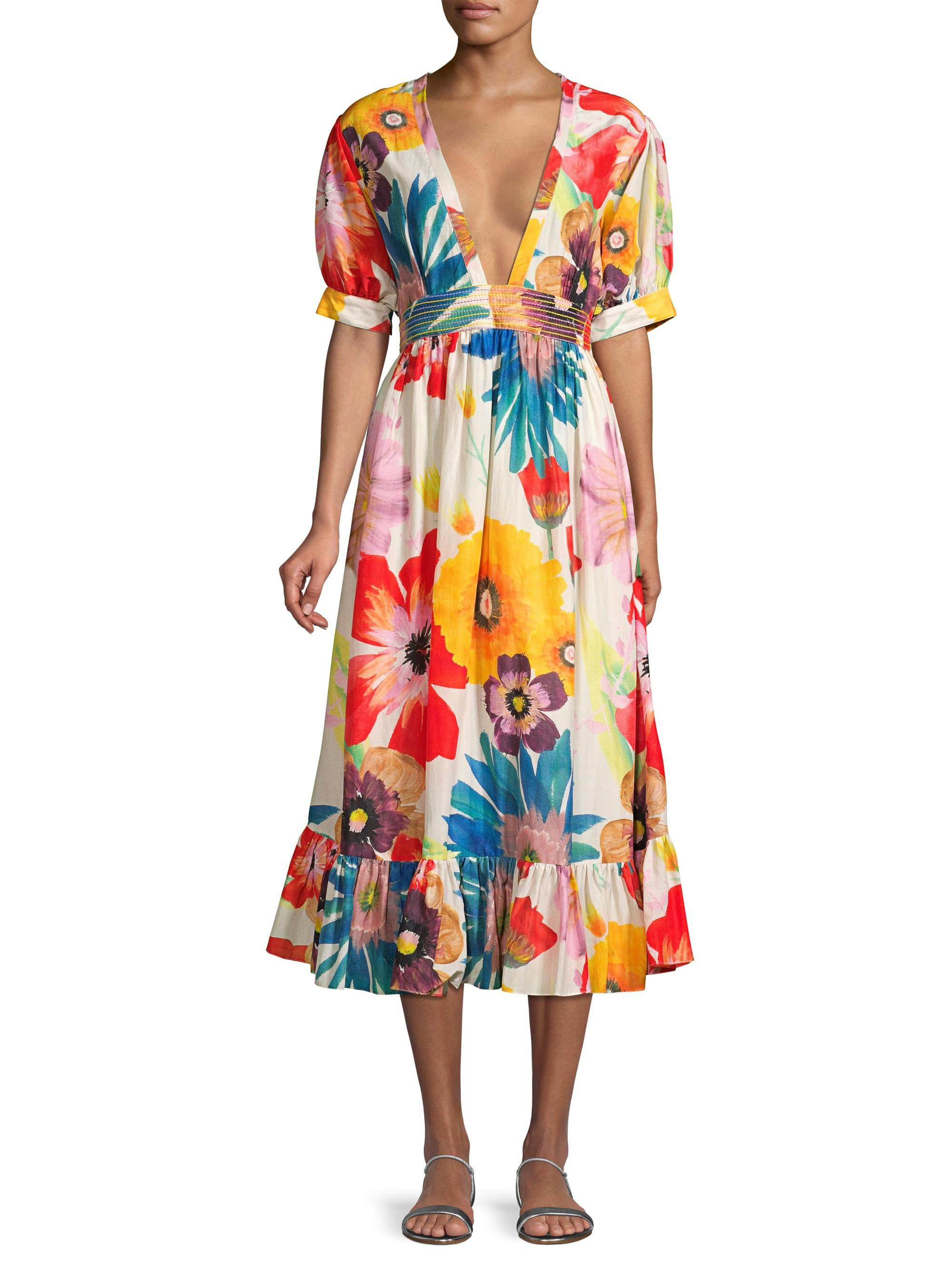 go bold with this  midi dress  full of vibrant colors and oversized florals!