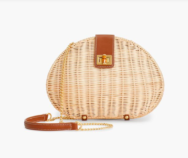the bamboo turnlock and leather details add a fun touch to this  classic wicker bag !