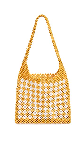 add the perfect pop of color to any outfit with this  bright beaded bag  (now under $200)!