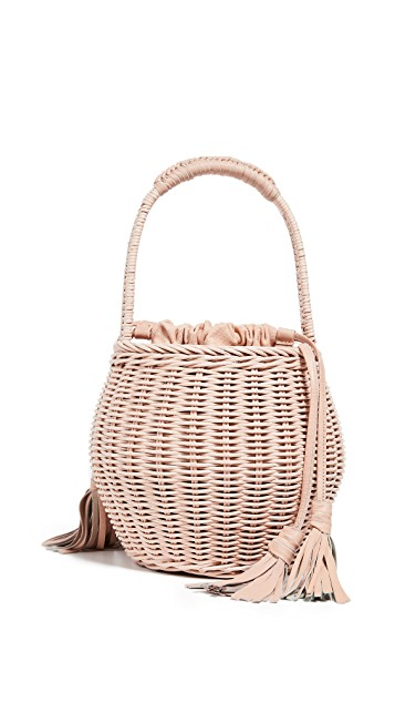 pretty in light pink! You know we can't resist a  wicker bag  - especially when it's under $85!