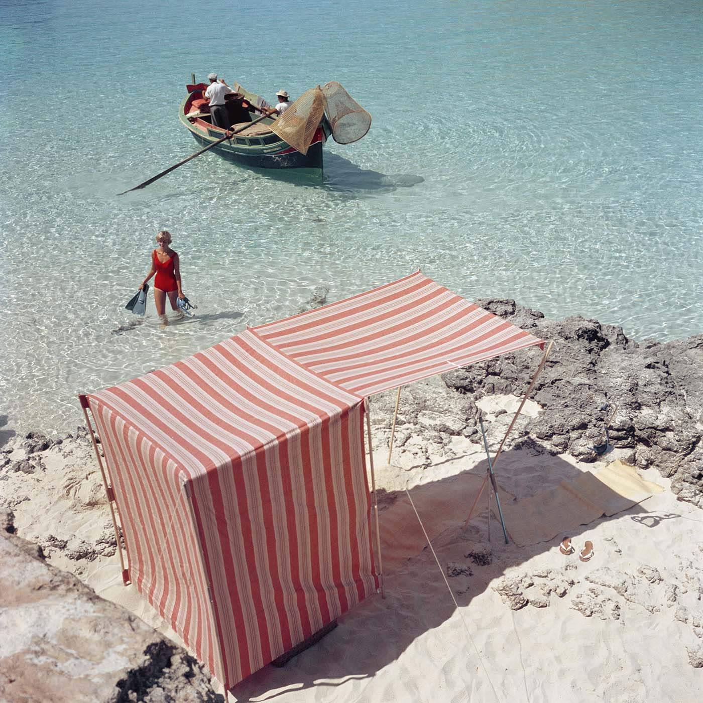 file this under places we'd rather be! photo:  slim Aarons